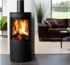 The Westfire Uniq 26 Wood burning Stove is the perfect stove for modern life. Featuring a sleek slim design with a flush fitting stainless steel handle, the Uniq 26 wood burning stove will create a stunning focal point in any room. The large rounded gl Wood Burning Stoves Uk, Wood Burning Logs, Wood Stoves, Multi Fuel Stove, Freestanding Fireplace, Freestanding Stoves, Pellet Stove, Wood Pellets, Stove Fireplace