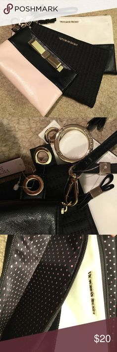 """Victoria's Secret Set of 3 cosmetic bags.  Removable ring so you keep them all together or use them separately.  Smallest pouch also doubles as a wristlet with removable strap.  Largest bag measures about 10""""L x 7""""H. Victoria's Secret Bags Cosmetic Bags & Cases"""