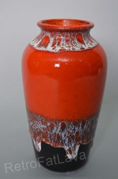 West German Jasba Keramik vase Beautiful glazed in red and brown with white lava  Marked N 046 10 24 Height 24 cm  Condition: Excellent - - no