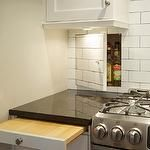 kitchens - subway tile white black grout granite stainless cabinets hidden storage chopping board pullout compartment  Ingenious kitchen design