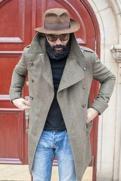 Shop this look on Lookastic:  http://lookastic.com/men/looks/brown-hat-blue-jeans-black-turtleneck-grey-overcoat/6654  — Brown Wool Hat  — Blue Jeans  — Black Turtleneck  — Grey Overcoat