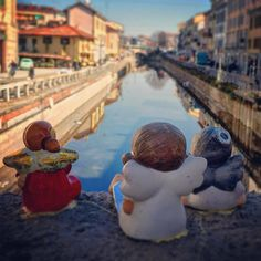 Even these little angels are enjoying the sunny view from the bridge over the Navigli.  #guardianangels #naviglimilano #milano_forever #milanodavedere #milanoinsight by countrygirl.citygirl