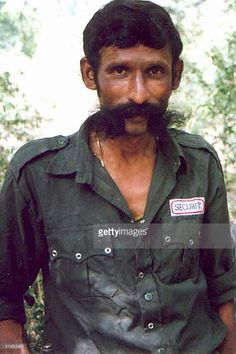 An undated file photo shows India's most wanted man, Koose Muniswamy Veerappan. India's most wanted criminal, Veerappan, who was accused of more than 100 murders, has been shot dead after decades on the run, police said 19 October 2004. The bandit, said to be around 60 years old now, was killed in a forest in southeastern Tamil Nadu state, said Special Task Force chief K. Vijay Kumar.