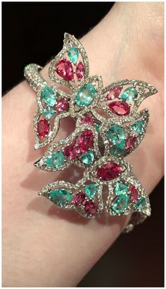 A glorious butterfly cuff bracelet with gemstones and diamonds. By Sutra.