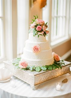 Round Wedding Cake With Roses on silver square cake stand .....beautiful