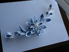 This stylish, elegant hair piece features a beautiful hand made Kanzashi flower.  Suitable for a wedding, prom, party or any special occasion.  This flower will look elegant on a bridal dress or as a shoulder corsage or as a hair piece for a bride.  Please visit my shop at www.etsy.com/shop/lihinicreations .
