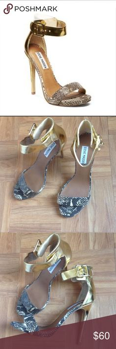 Steven Madden gold sandals Steven Madden gold and snake skin sandal . Only used once , great conditions. Heels 5 inches Steve Madden Shoes Heels