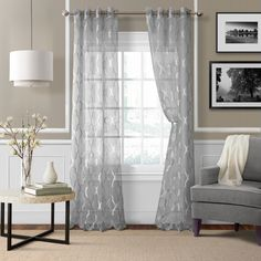 The Sonata sheer curtains feature an ironwork trellis jacquard on a silky sheer ground. These stylish window panels offer light filtering benefits and a luxurious sheen. inch silver grommets are Elrene Home Fashions, Mattress Furniture, Curtains, Panel Curtains, Drapes Curtains, Sheer Curtain Panels, Grommet Panels, Grommet Curtains, Window Treatments Sheer