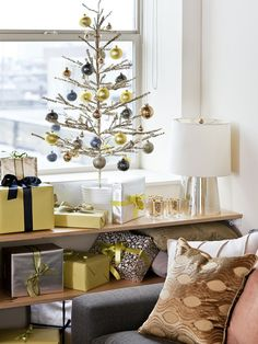 Modern Christmas Glamour  Golden baubles, high-end finishes and metallic trees are all excellent ways to bring your Christmas decor into the 21st Century. Moving beyond the traditional red and green is a big step toward embracing a modern color palette. Here, green, blue and gold decorations add holiday sparkle to this cozy living room.