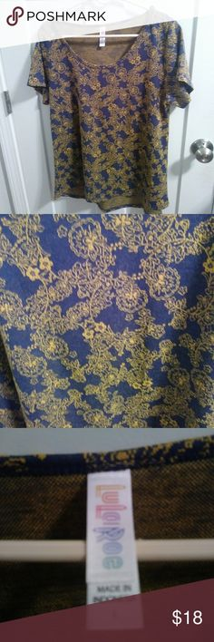 NWOT LuLaRoe floral Irma Beautiful navy background with gold floral arrangements throughout. Soft shortsleeve top, flowy size large. Brand new without tags, never worn or washed. LuLaRoe Tops