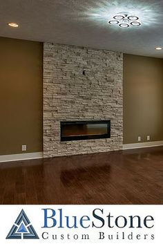 This fireplace blends the sophistication of a high end fireplace with a rustic stone. #Omaha #CustomHome #BlueStoneHomes www.bluestonecustombuilders.com