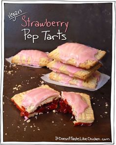 Homemade baked Vegan Strawberry Pop Tarts! Umm... yes please!!! This is a fun baked treat for kids or to take to a party, just look how cute they are! #itdoesnttastelikechicken