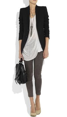 The simple white, slouchy shirt pairs well with the gray skinny jeans and black blazer.