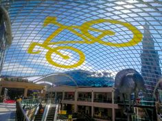 Big yellow bike for Trinity in Leeds. Land Art, sand drawings or rooftop art, we can create huge drawings almost anywhere!