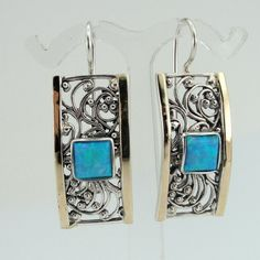 Handcrafted filigree earrings of 9K gold, sterling silver and opal by jewela at Etsy