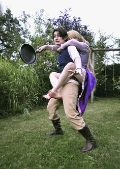 Tangled cosplay. ~ Somebody needs to give these two a high five for Awesome cosplay and picture pose! :)