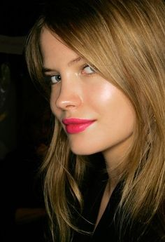 bold pink lip and dewy skin makes for a fun and flirty look