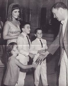 Elizabeth Taylor & her children, on the set of 'Cleopatra'., ....Uploaded By  www.1stand2ndtimearound.etsy.com