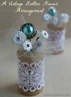 A vintage Button Flower Arrangement.hmmm, needs more button flowers.I love vintage buttons and this would be a great way to display some of them! Wooden Spool Crafts, Cork Crafts, Wooden Spools, Button Bouquet, Button Flowers, Button Wreath, Diy Buttons, Vintage Buttons, Buttons Ideas