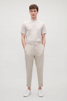 Made from cotton with a light stretch, these trousers have an oversized fit for a relaxed look. A design with an elasticated waistline it has turn-up details, welt pockets and neat press folds along the front. trousers trousers for drawers Fashion Moda, Mens Fashion, Fashion Outfits, Casual Outfits, Latest Clothes For Men, Men's Wardrobe, Fashion Essentials, Minimal Fashion, Men Casual