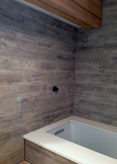 The new wood grain tile that I selected goes up for the shower surround.  I love how it looks like weathered barn boards!