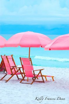 Soooo pretty...Pink umbrellas and chairs in front of the blue water