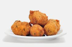 """Try a new """"spin"""" on one of the best traditional Jamaican appetizers, Stamp and Go. Carrot Salt Fish Fritters can be eaten as part of an island breakfast. Beer Recipes, Fish Recipes, Seafood Recipes, Appetizer Recipes, Soup Recipes, Dessert Recipes, Cooking Recipes, Jamaican Ginger Beer Recipe, Jamaican Recipes"""