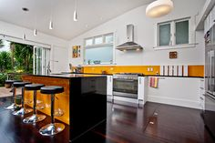 Retro inspired kitchen with pop of color. Bungalow Renovation/ Character Home restoration by Auckland's leading home renovation specialists. Contact Haven Renovations, visit www.havenrenovations.co.nz