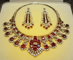 Necklace that converts into a tiara, Cartier, circa 1920s. Designed as twelve, pigeon's blood ruby and diamond motifs, flanking a central cluster of rubies, topped with a spray of diamonds. British Museum Cartier London