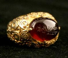 Safavid Gold Ring Featuring a Garnet with Islamic Inscription Central Asia 17 th Century AD to 18 th Century AD