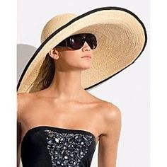 So love oversized beach hats...with a black maillot swimsuit...and huge black sunglasses...