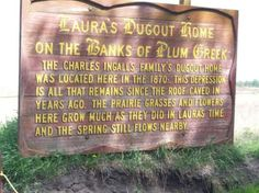 The Ingalls family dugout home located on The Banks of Plum Creek was located starting just below this sign.