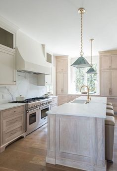 Transitional two-tone kitchen designed with a light oak kitchen island topped wi. Transitional two-tone kitchen designed with a light oak kitchen island topped with honed white marble including a farmhouse sink with a brushed gold gooseneck faucet. Home Decor Kitchen, Interior Design Kitchen, Home Kitchens, Kitchen Ideas, Kitchen Island Top Ideas, Kitchen Island With Sink, Decorating Kitchen, Interior Plants, Small Kitchens