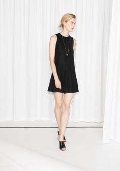 Chic and classic, this above-the-knee dress has a flattering A-line shape.