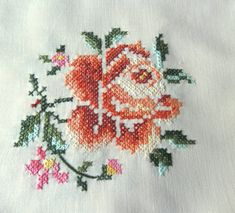 Beautiful vintage hand-embroidered tablecloth 1960s 100% cotton, cross stitching . Decorative, rich colorful floral pattern - large roses. Ecru beige background. Meticulous craftsmanship. Size: 66 x 50 Material: cotton Vintage, as-new condition, never used. Freshly washed and