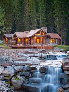 Rustic Cabin With Pond and Waterfall. I would imagine this is the way the land slopes, but would have preferred the waterfall to face the house as a view from inside. Swimming Pool Waterfall, Swiming Pool, Beautiful Homes, Beautiful Places, House Beautiful, Amazing Places, Amazing Photos, Beautiful Scenery, Amazing Things