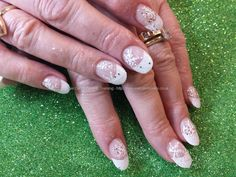 White french tips with freehand christmas snowflake nail art