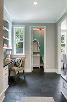 The herringbone design in the mudroom and pocket office are Montauk Slate 4 x 16.