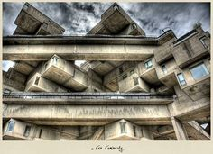 Originally built as a pavilion for Expo Montreal's Habitat 67 is considered to be one of the most notable architectural landmarks in Canada. surreal buildings that look like they belong in an MC Escher painting Escher Paintings, Hdr Architecture, Houses In Poland, Expo 67, Of Montreal, Famous Architects, World's Fair, Parcs, Brutalist