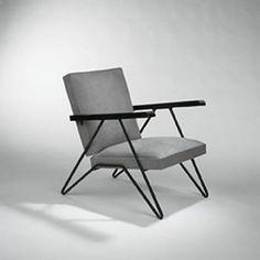 MATHIEU MATÉGOT    lounge chair    France, 1950s  iron, wood, suede  24 w x 30.5 d x 30 h inches