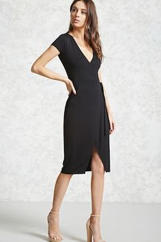 A knit wrap dress featuring a surplice neckline, short sleeves, side-tie, and a tulip hem.
