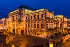 View of the facade of the Vienna State Opera illuminated at night with light trails from cars. Vienna State Opera, Light Trails, Austria Travel, Facade, Louvre, Europe, Night, Building, Cars