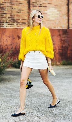 Mini skirt with a bright sweater and flats.