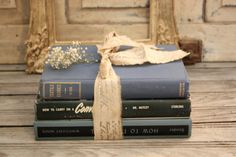books tied with printed ribbon