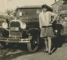 African American woman standing besides a Ford model A roadster. Rural Georgia, 1920s.