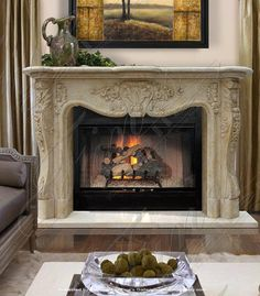 MFP-1116 - Luxury Marble Fireplace - Indulge in the luxury and timeless beauty of fine marble. Immaculate floral details are finely hand-carved throughout for a display of timeless elegance. Shown in a beautiful antique marble and available for customization.