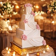 """""""The buttercream cake was decorated with elegant draping and fresh roses."""""""