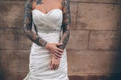 heavily tattooed bride with two full sleeves wearing a strapless wedding dress