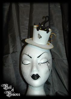 Cat-In-Teacup. Super cute teacup hat with a cat stalking a little butterfly. £29