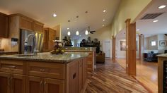 Ever considered combining two different floors? We love Tobacco Road Acacia + Red Oak! Both are floors by Builder's Pride.